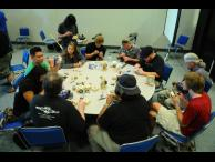 Attendees practicing their picking skills at the lockpicking village. Photo by visago.